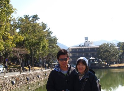Jesse and his mom in front of a pond in Nara