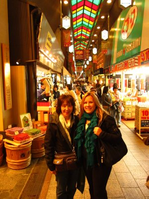 Jacq and Emi in the food market