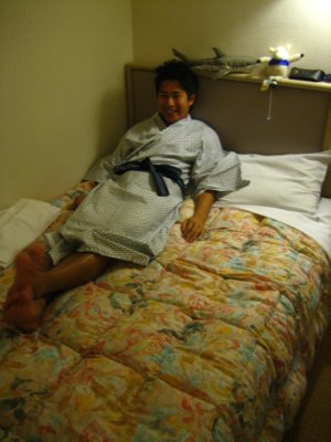 Jesse in his yukata's (Japanase PJ's) and on our semi-double bed (YUP pretty tiny!)