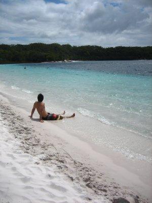 Jesse on the beach at Lake MacKenzie