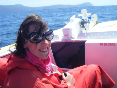 Me on the boat looking like an old lady wrapped in her favourite red blanket