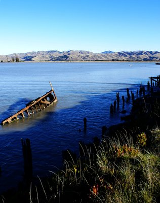 rotting jetty and boat, Wairau Bar nr Blenheim