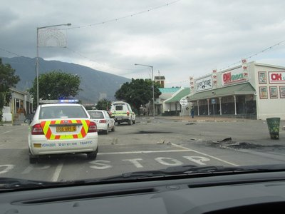 Police escort through the barricades of Swellendam
