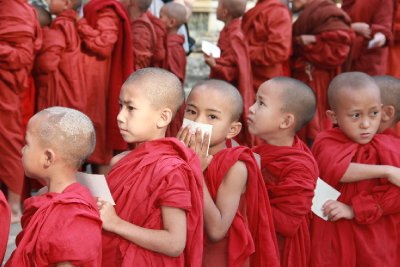 young monks lined up
