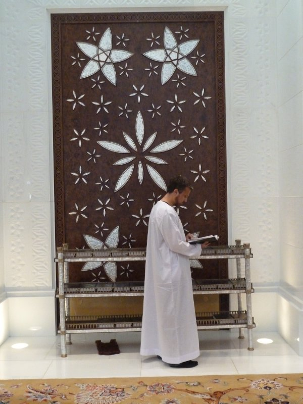 Cathcing up on some reading at the Sheikh Zayed Grand Mosque, Abu Dhabi