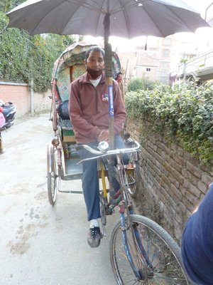 our mighty Rickshaw driver at payment time