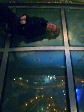 Yoselien lying on the glass floor