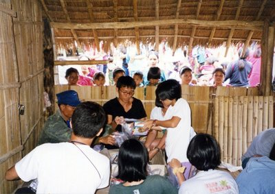 Giving supplies to needy hill tribe near Chiang Mai Thailand