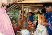 Giving clothes to needy Lahu hill tribe children during our trek