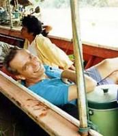 Riding the long tail boat on the Mae Kok River Thailand