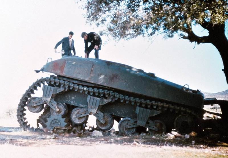 Ade and Mahoumet Inspect Wrecked Tank