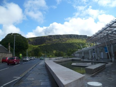 Sco'ish Parliament, with Holyrood Park in the background