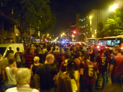 The crowd takes over the street in an attempt to get home