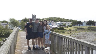 The family with Logan and Lola (the dog) in Aberaeron