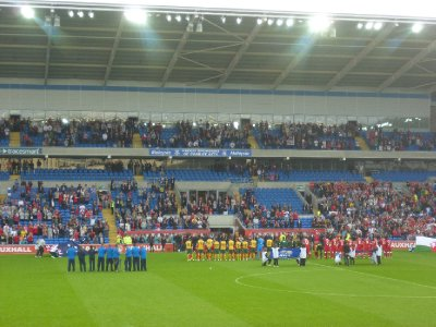 The teams line up for the anthems