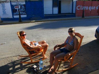 Sunbathing in rocking chairs