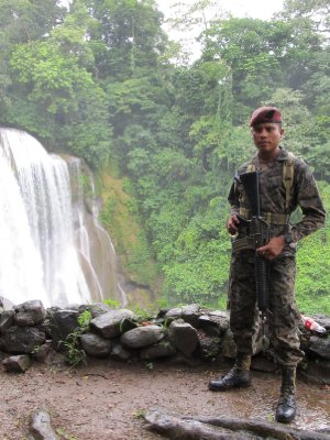 Soldier guarding the Pulhapanzak waterfalls