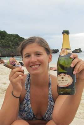 Sparkling wine and a cigar on the beach