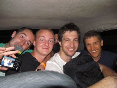 4 guys squeezed into the back of a taxi...