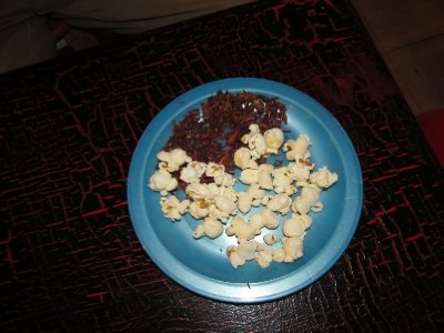 Popcorn and grasshoppers served as snacks with the mezcal