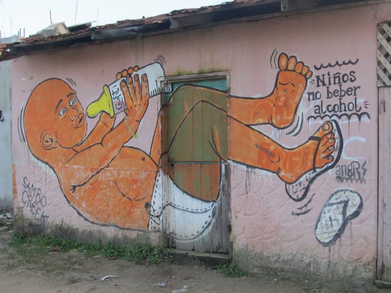 House front painting warning that children should not drink alcohol