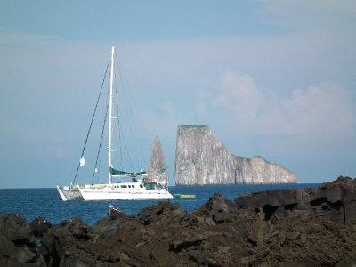 Our boat with Kicker Rock behind