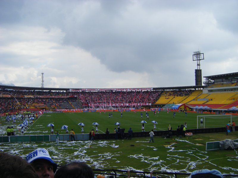 The stadium (the right side under maintanence); the pitch strewn with paper