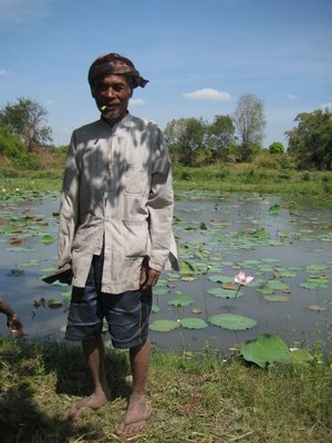 kheang&#39;s father smoking local tobacco, lotus pond