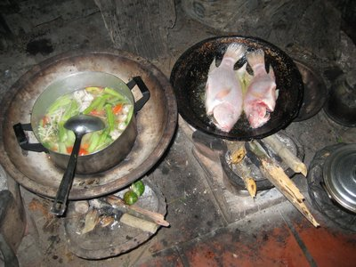 cooking over wood fire at home stay