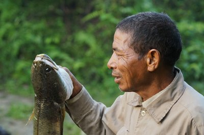 Fisherman with Catfish