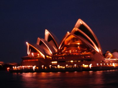 the opera house at night from the ferry
