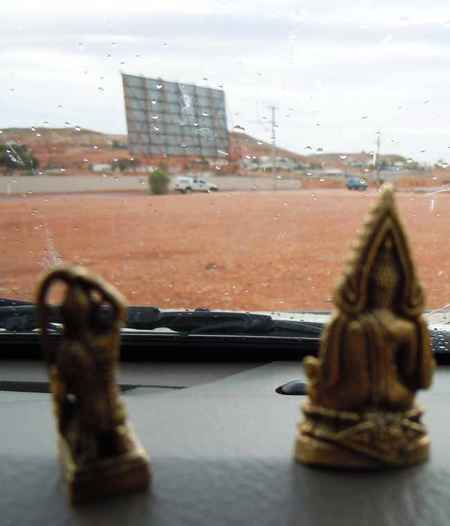 Buddha and Mae Thorannee go to the drive-inn movie theatre