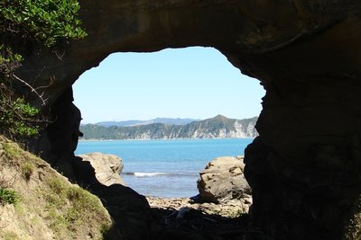 The hole in the rock at Cooks Cove, looking back through to Tolaga Bay.