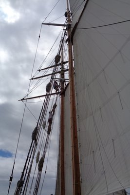 Hoisting the sails onboard the ship.