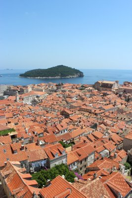 A tapestry of tarracotta and the island of Lokrum in the background