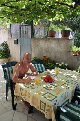 Eating breakfast on our terrace (fresh tomatoes from the garden left for us for lunch)