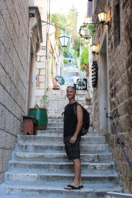 Andrew climbing the steps to Hvar's old town