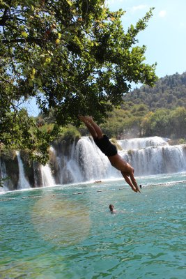 Andrew leaping from trees into the Krka river