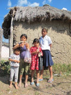 Chorti children from the village selling corn husk dolls