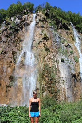 Ana under the large waterfall