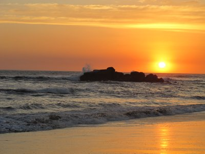 Waves crashing and sun setting at Las Penitas