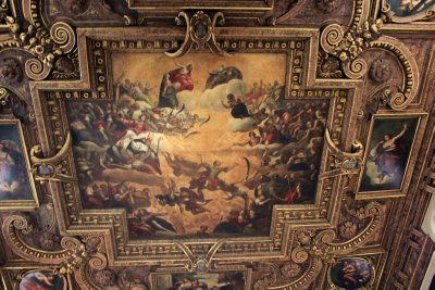 Paintings with golden frames on the ceilings of the Palace