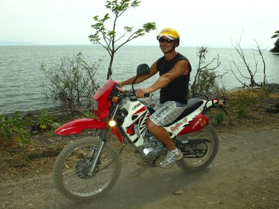 Andrew and his bike infront of Lake Nicaragua