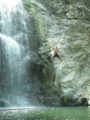 Andrew leaping from waterfalls