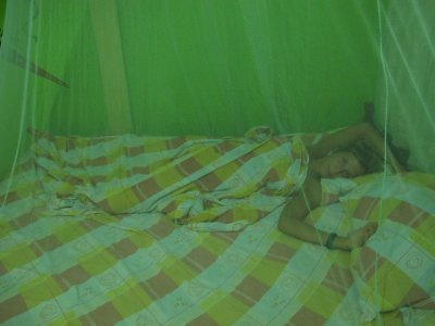 Ana under the mosquito net -SO many mosquitos in Puerto Viejo
