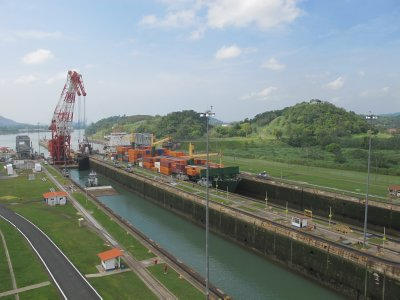 A ship enters the first stage of the Miraflores Locks.  The gate closes and water will fill the lock and lift the ship as if in a water elevator to the second stage.
