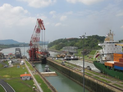 A large floating crane does maintenance on a section of the Locks