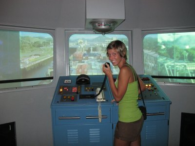 Ana guiding a ship through the canal -Ok, it was a simulator in the museum but it was fun trying!