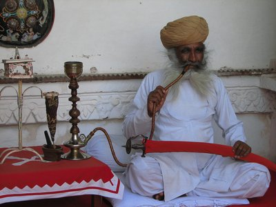 Smoking his water pipe