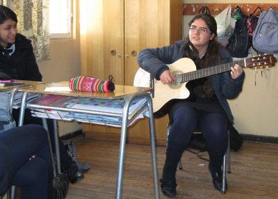 Chilean student playing some beautiful songs during class